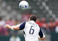 New England Revolution defender Jay Heaps (6) sends a headball downfield during a MLS game. The New England Revolution defeated the Chivas USA 2-1 at Home Depot Center Stadium, in Carson, Calif., on Sunday, May 11, 2008.