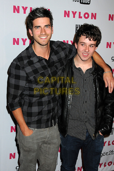 RYAN ROTTMAN & GUEST.Nylon Magazine's Young Hollywood Party held at the Roosevelt Hotel's Tropicana Bar, Hollywood, California, USA..May 12th, 2010.half length black leather jacket grey gray plaid check shirt arm over shoulder .CAP/ADM/BP.©Byron Purvis/AdMedia/Capital Pictures.