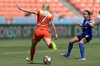 Houston, TX - Saturday May 27, 2017: Kealia Ohai takes a shot on goal during a regular season National Women's Soccer League (NWSL) match between the Houston Dash and the Seattle Reign FC at BBVA Compass Stadium.
