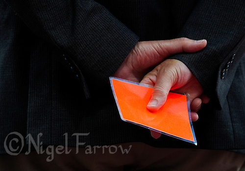 05 AUG 2012 - LONDON, GBR - A race official holding a red card  watches the women's 400m hurdles round 1 heats during the London 2012 Olympic Games athletics in the Olympic Stadium at the Olympic Park in Stratford, London, Great Britain .(PHOTO (C) 2012 NIGEL FARROW)