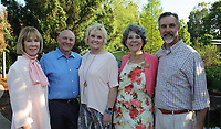 NWA Democrat-Gazette/CARIN SCHOPPMEYER Linda McMath, Botanical Garden of the Ozarks board president (from left), Jay and Judy McDonald, honorary Greening of the Garden chairmen, and Charlotte Taylor, executive director, and Tim Hudson welcome guests to the fundraiser May 9 at the garden in Fayetteville.
