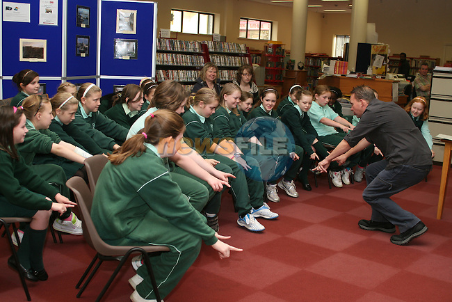 Poet Sandy Sneedon with the kids at the Poetry Reading for Kids in Drogheda Library...Photo NEWSFILE/Jenny Matthews.(Photo credit should read Jenny Matthews/NEWSFILE)....This Picture has been sent you under the condtions enclosed by:.Newsfile Ltd..The Studio,.Millmount Abbey,.Drogheda,.Co Meath..Ireland..Tel: +353(0)41-9871240.Fax: +353(0)41-9871260.GSM: +353(0)86-2500958.email: pictures@newsfile.ie.www.newsfile.ie.FTP: 193.120.102.198.