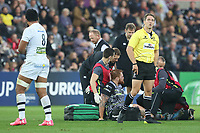 Referee Andrew Brace watches the replay as Dan Baker of Ospreys is tended to by physics after landing on his ankle after an in the air tackle from Fritz Lee of Clermont during the Champions Cup Round 1 match between Ospreys and Clermont at The Liberty Stadium, Swansea, Wales, UK. Sunday 15 October 2017