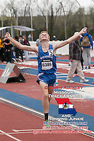 Winfield (Ks) junior Riley Osen celebrates victory as he crosses the finish line first in the 3200-meters in 9:13 at the 2015 Kanas Relays.
