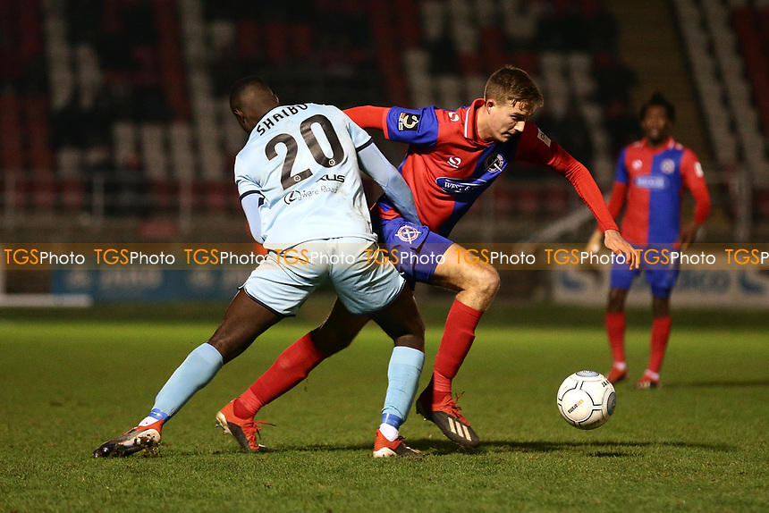 Will Wright of Dagenham and Justin Shaibu of Boreham Wood during Dagenham & Redbridge vs Boreham Wood, Vanarama National League Football at the Chigwell Construction Stadium on 5th January 2019