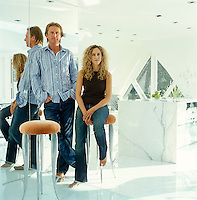 Portrait of owner/architect Harvey West and his partner Melanie Moray in the kitchen area of the penthouse