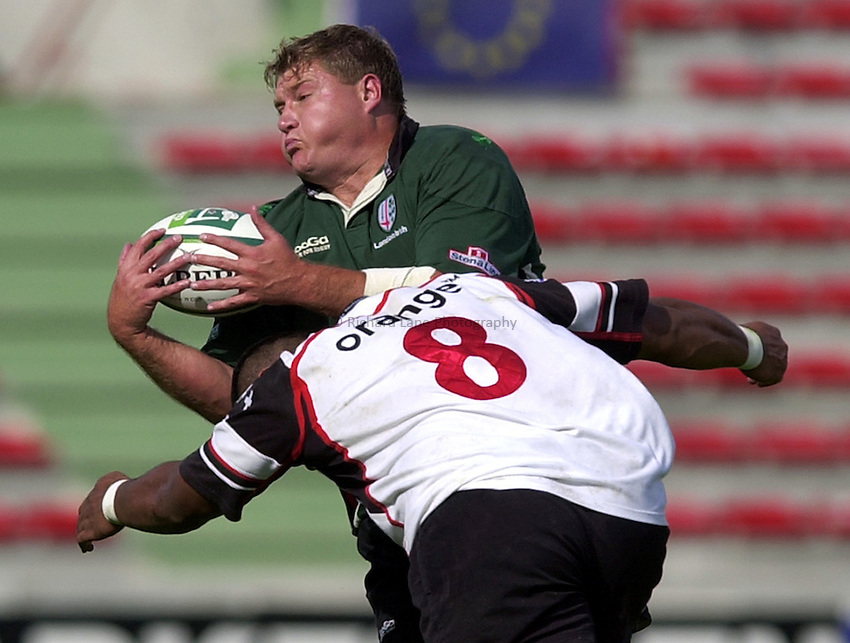 Photo. Richard Lane. .Toulouse v London Irish. Heineken Cup. 12-10-2002..Neal Hatley is tackled by Isitolo Maka.
