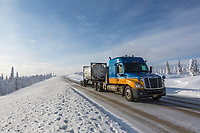 Truck travels the icy James Dalton Highway in winter.