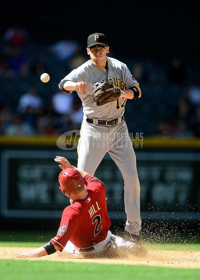 Apr. 18, 2012; Phoenix, AZ, USA; Pittsburgh Pirates shortstop Clint Barmes throws to first to complete the double play after forcing out Arizona Diamondbacks base runner (2) Aaron Hill in the eighth inning at Chase Field.  Mandatory Credit: Mark J. Rebilas-