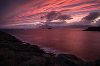 Coloful sunset from the Island of Skrova with Lofoten Islands in the distance, Norway