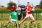 Rathmore full forward Shane Ryan goes around Donal Maher Kilcummin during the Club Championship clash in Rathmore Wednesday evening
