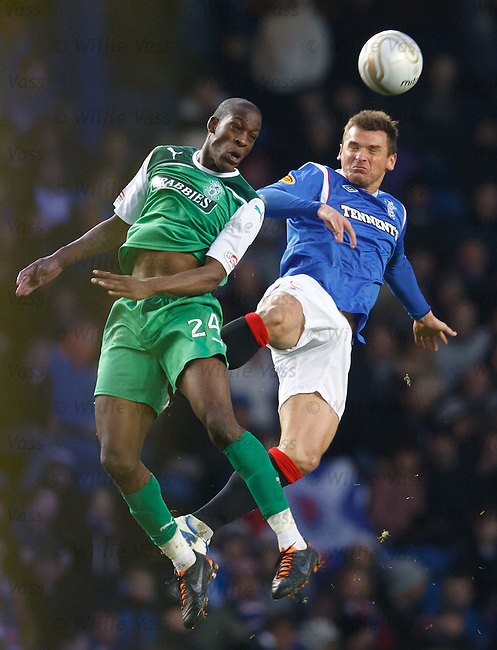 Isiah Osborne and Lee McCulloch compete for a high ball