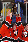 Chris Wilberding (center), Birmingham Brother Rice, celebrates with teammates Mackenzie MacEachern (left) and Thomas Ebbing after defeating Grosse Pointe South in Division 2 State Championship action at Compuware Arena Saturday, March 10, 2012.