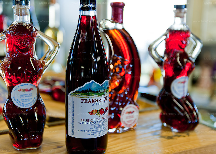 Colorful fruit wines are packaged in exotic shapes and themed bottles at Peaks of Otter Winery.