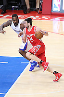 02/22/15 Los Angeles, CA:Houston Rockets forward Kostas Papanikolaou #16 and Los Angeles Clippers forward Glen Davis #0 in action  during an NBA game played at Staples Center.