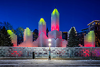 2018 Saint Paul Winter Carnival Ice Palace with red and yellow lighting. The ice palace was built in Rice Park downtown St. Paul, Minnesota.