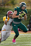 OCTOBER 4, 2014 -- Alex Anderson #81 of Black Hills State looks for more yardage while Colorado Mesa tackler Blake Nelson #42 tries to wrap him up during their Rocky Mountain Athletic Conference game Saturday at Lyle Hare Stadium in Spearfish, S.D.  (Photo by Dick Carlson/Inertia)