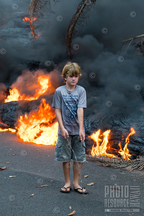 May 2018: A young boy stands near the Kilauea Volcano eruption in Leilani Estates, Puna, Big Island of Hawai'i.