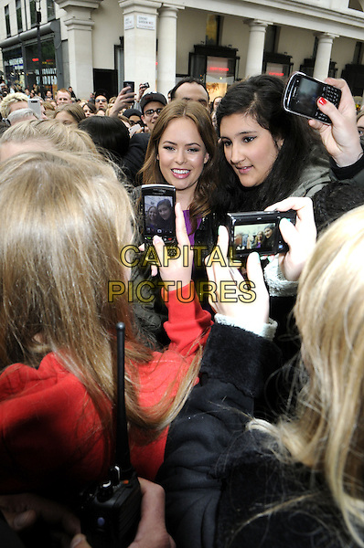 Beauty blogger Tanya Burr is swamped by fans at her meet and greet in Covent Garden, London, England.<br /> May 29th 2013<br /> half length purple dress black leather jacket crowd mob posing taking picture photograph <br /> CAP/PP/BK<br /> &copy;Bob Kent/PP/Capital Pictures