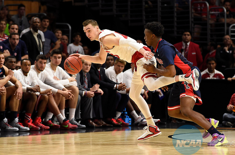 28 MAR 2015:  Stanley Johnson (5) of the University of Arizona defends Sam Dekker (15) of the University of Wisconsin during the 2015 NCAA Men's Basketball Tournament held at the Staples Center in Los Angeles, CA.  Wisconsin defeated Arizona 85-78 to advance to the Final Four.  Jamie Schwaberow/NCAA Photos