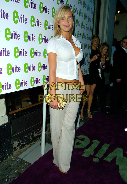 DANIELLE LLOYD. At the Evite.co.uk Website Launch Party, Cafe De Paris,.London, England, 12th July 2007..full length white shirt blouse grey beige wide leg trousers gold purse clutch bag midriff cleavage Dannielle.CAP/CAN.©Can Nguyen/Capital Pictures
