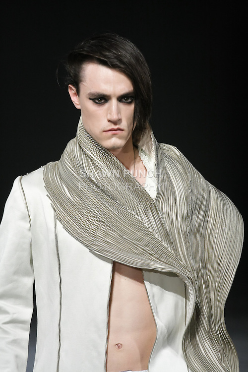Model walks runway in an Autumnlin Design outfit by Autumn Kietponglert, during Couture Fashion Week Fall 2011.
