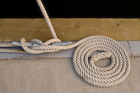 Coiled rope in a marina.