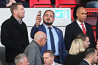 Charlton's new Chairman, Matt Southall (Top, far right) looks down at the pitch while new owner, His Excellency Tahnoon Nimer on his first visit to see a match at Charlton takes a selfie during Charlton Athletic vs Barnsley, Sky Bet EFL Championship Football at The Valley on 1st February 2020
