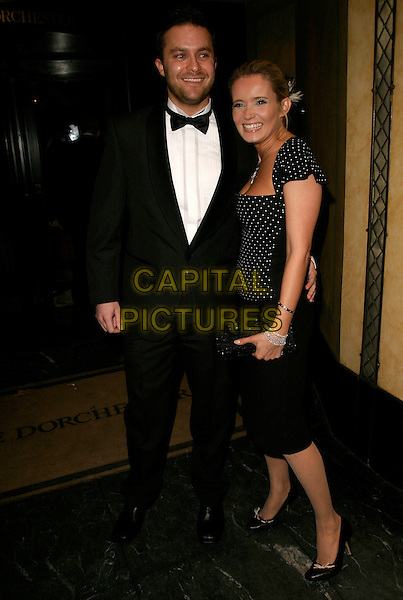 DANIELLE BRENT & GUEST.Arrivals at the UK Fifi Awards 2006, .The Dorchester, London, England, .March 27th 2006..full length .Ref: AH.www.capitalpictures.com.sales@capitalpictures.com.©Adam Houghton/Capital Pictures.