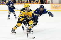George Mason's Cameron Smith (74) skates past George Washington defenseman John Wright (3). George Mason defeated George Washington 5-2 on 9-22-18.<br />