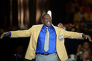 Canton, Ohio - August 6, 2015: Former NFL player Tim Brown dons his gold jacket for the first time during the 2015 Pro Football Hall of Fame enshrinement dinner in Canton, Ohio August 6, 2015. At time of his retirement, Brown amassed 14,934 receiving yards, second-highest total in NFL history. (Photo by Don Baxter/Media Images International)