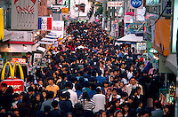 Overview of crowds along Takeshita-dori; a popular Japanese street for shopping. Tokyo, Harajuku district, Japan.