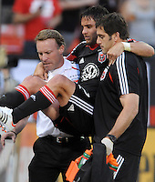 D.C. United midfielder Danny Cruz (2) gets help by staff after an injury that took him out of the game in the 26th minute of the game.  D.C. United defeated Toronto FC 3-1 at RFK Stadium, Saturday May 19, 2012.