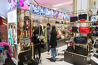 "Shoppers browse Kate Spade handbags in the Macy's Herald Square flagship store in New York looking for bargains on the day after Thanksgiving, Black Friday, November 28, 2014. Many retailers, including Macy's, opened their doors on Thanksgiving evening extending the shopping day and giving Thanksgiving the nickname ""Gray Thursday"". (© Richard B. Levine)"