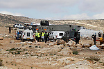 Israeli security forces stand guard during Israeli bulldozers demolish Palestinian homes in a disputed military zone in the area of Musafir Jenbah, which includes several villages, south of the West Bank town of Hebron on February 2, 2016. Israeli forces demolished at least a dozen buildings in a disputed military zone in the southern West Bank, leaving a number of families homeless, authorities and residents said. Israel has carried out a long campaign to relocate the residents of the area, which was declared a military zone by the Israeli government in the 1970s. Photo by Wisam Hashlamoun