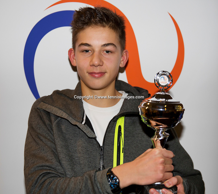 Almere, Netherlands, December 6, 2015, Winter Youth Circuit, Winner boys 14 years: Amadatus Admiraal with the trof<br /> Photo: Tennisimages/Henk Koster