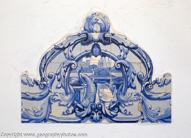 Historic Portuguese ceramic alejuzo tiles showing peacock and swans on wall inside hilltop village of Monsaraz, Alto Alentejo, Portugal, southern Europe