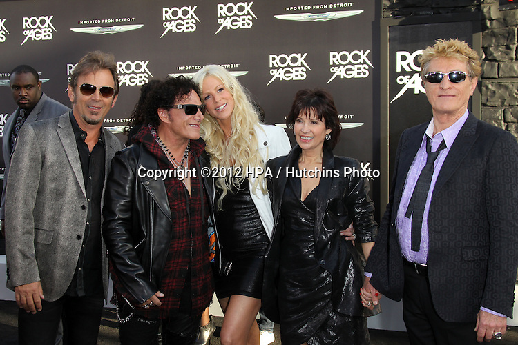 "LOS ANGELES - JUN 8:  Neal Schon, Michaele Salahi arriving at ""Rock of Ages"" World Premiere at Graumans Chinese Theater on June 8, 2012 in Los Angeles, CA"