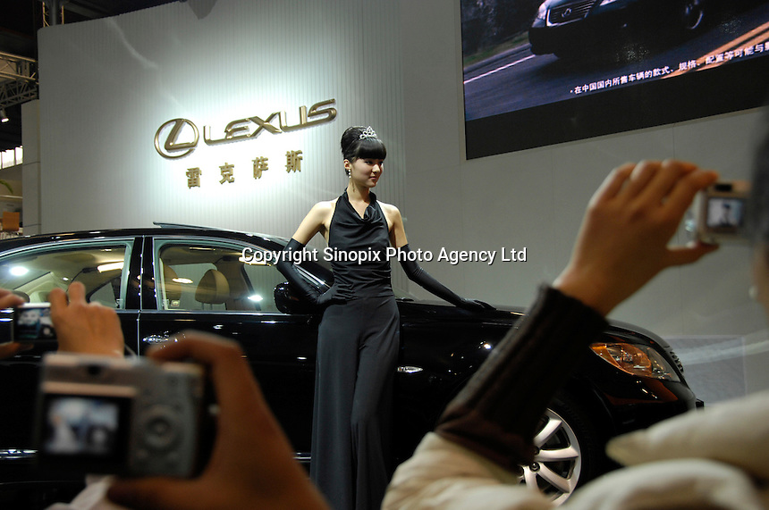 A model poses with a Lexus at the 2006 International Automotive Exhibition in Beijing China..25 Nov 2006