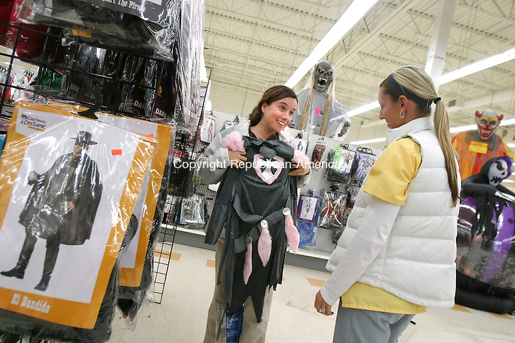 WATERBURY, CT; 23 OCTOBER 2006; 102206BZ02-  Stacy Cavallo, 26, of Watertown, left, and Kara Rosa, 26, of Thomaston, look at costumes at the Halloween Costume Warehouse in Waterbury Monday afternoon.<br />  Jamison C. Bazinet Republican-American