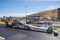 Aug 2, 2015; Sonoma, CA, USA; NHRA top fuel driver Antron Brown (near) races alongside Tony Schumacher during the Sonoma Nationals at Sonoma Raceway. Mandatory Credit: Mark J. Rebilas-