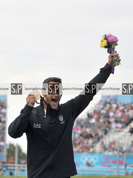 Daniele Molmenti (ITA) celebrates with his gold medal. Kayak K1 Men - PHOTO: Mandatory by-line: Garry Bowden/SIP/Pinnacle - Photo Agency UK Tel: +44(0)1363 881025 - Mobile:0797 1270 681 - VAT Reg No: 768 6958 48 - 01/08/2012 - 2012 Olympics - Greenwich, London, England.