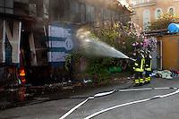 Roma  20 Luglio 2007.I  pompieri, intervengono in via della Stazione Tuscolana, per un incendio divampato in uno zuccherificio.Rome July 20 th 2007  .The firefighters intervene at the street of the Station Tuscolana  for a fire in a sugar refinery