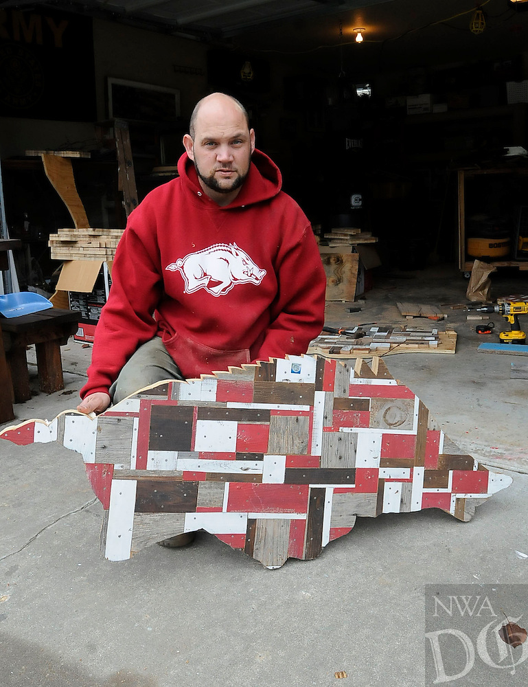 STAFF PHOTO FLIP PUTTHOFF <br /> Razorback plaques that Emmett makes       Saturday Oct. 11 2014     from old lumber are a top seller.