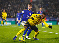 9th November 2019; King Power Stadium, Leicester, Midlands, England; English Premier League Football, Leicester City versus Arsenal; Alexandre Lacazette of Arsenal attempts to stay on his feet under pressure from James Maddison of Leicester City - Strictly Editorial Use Only. No use with unauthorized audio, video, data, fixture lists, club/league logos or 'live' services. Online in-match use limited to 120 images, no video emulation. No use in betting, games or single club/league/player publications