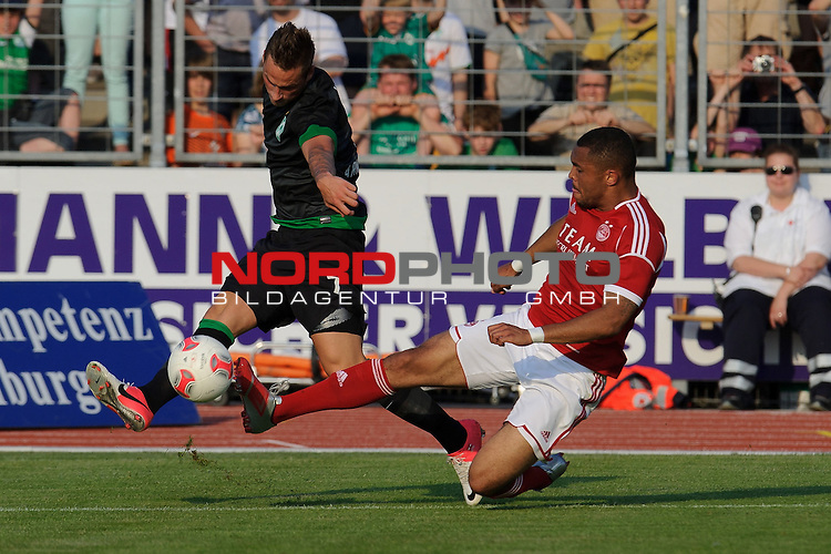 25.07.2012, Marschwegstadion, Oldenburg, GER, 1. FBL, FSP, SV Werder Bremen vs. FC Aberdeen, im Bild<br /> Marko Arnautovic (Bremen #7) vs Josh Megennis (Aberdeen #21)<br /> Foto &copy; nph / Kokenge *** Local Caption ***