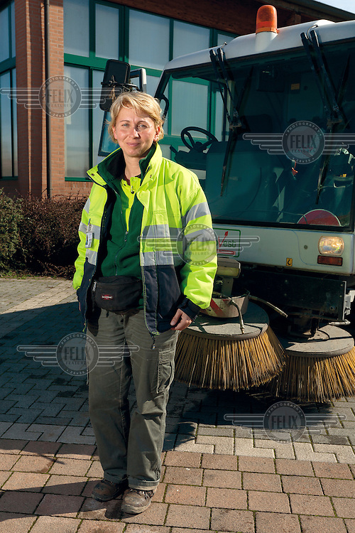 A woman who works for the small provincial town of Funo's street cleaning services.
