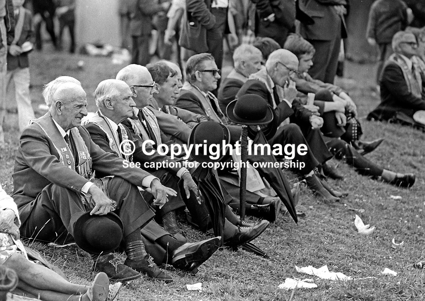 The Twelfth, Belfast, 12th July 1974, Orangemen listening to speeches at The Field at Edenderry. 197407120383b<br />