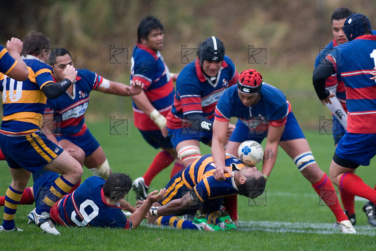 Simione Saravanua gets bent backwards as he is hit a strong tackle by Piula Fa'aselele. CMRFU Counties Power 2008 Club rugby McNamara Cup Premier final between Ardmore Marist & Patumahoe played at Growers Stadium, Pukekohe on July 26th.  Ardmore Marist won 9 - 8.