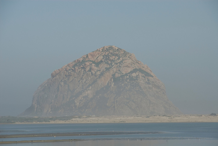 California, San Luis Obispo County: Morro Bay State Park, with Morro Rock, artists painting Morro Rock, rangers leading walks, and a heron rookery.  View of Morro Rock..Photo caluis171-70887..Photo copyright Lee Foster, www.fostertravel.com, 510-549-2202, lee@fostertravel.com